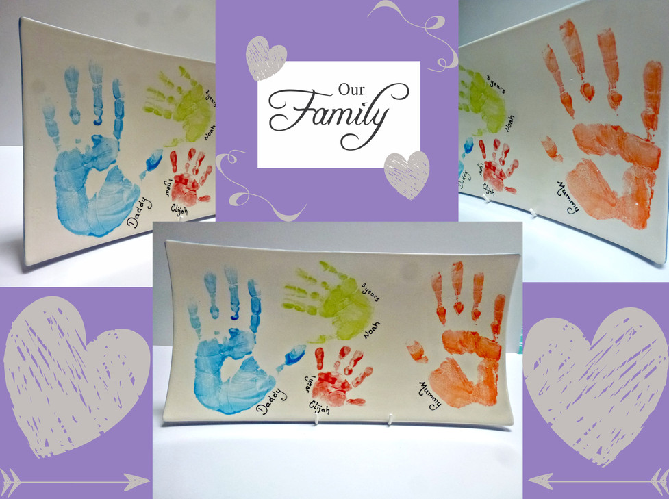 family hand prints on pottery