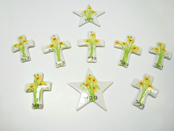 daffodils painted onto crosses and stars