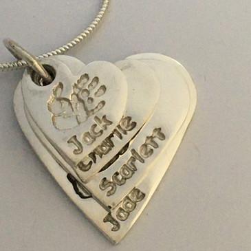 hand prints in silver pendants