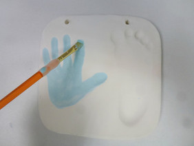 Painting baby clay imprints