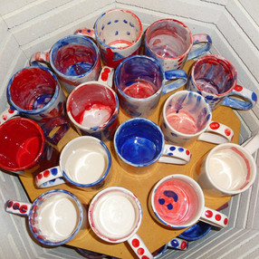 Kiln full of mugs from a workshop