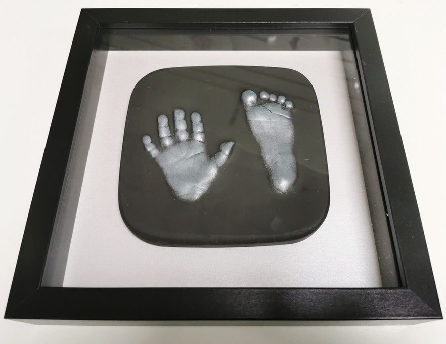 Framed baby plaster outprints