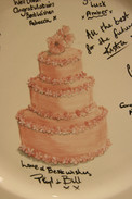 Close up detail of wedding cake painted onto plate.