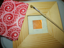 Decoupaging a mirror frame