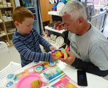 Father and son doing foam clay activity