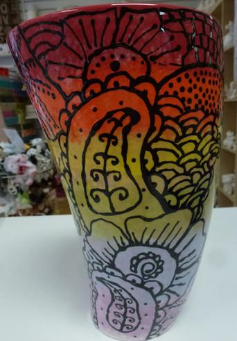 Beautifully painted rainbow vase