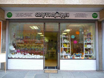 Looking at Crafty Monkey shop front from the outside