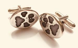 cufflinks with paw prints