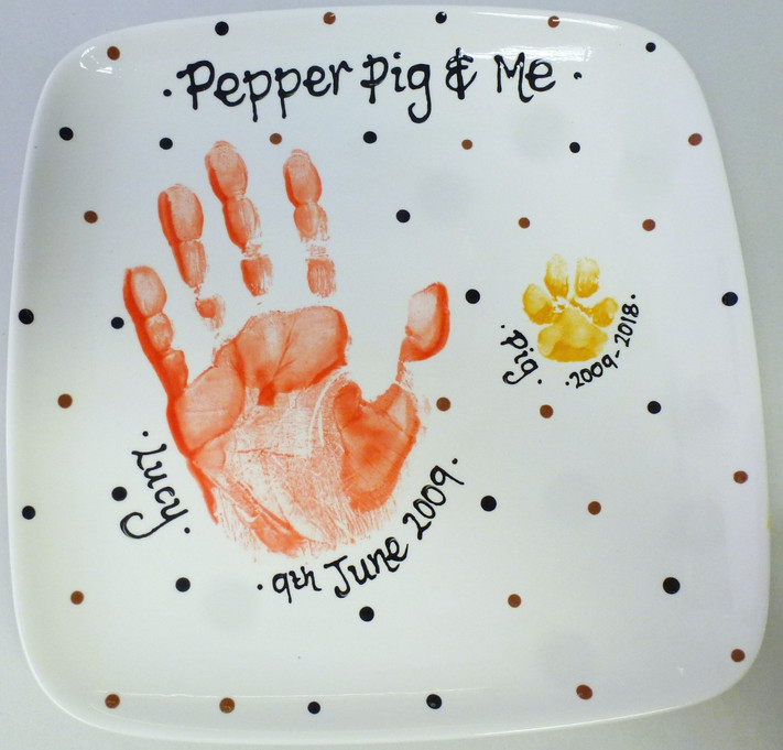 hand print and paw print on plate