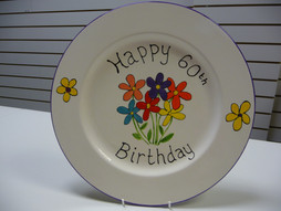 flowers painted on plate for 60th birthday