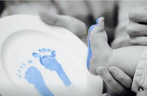 baby foot print on plate.jpg