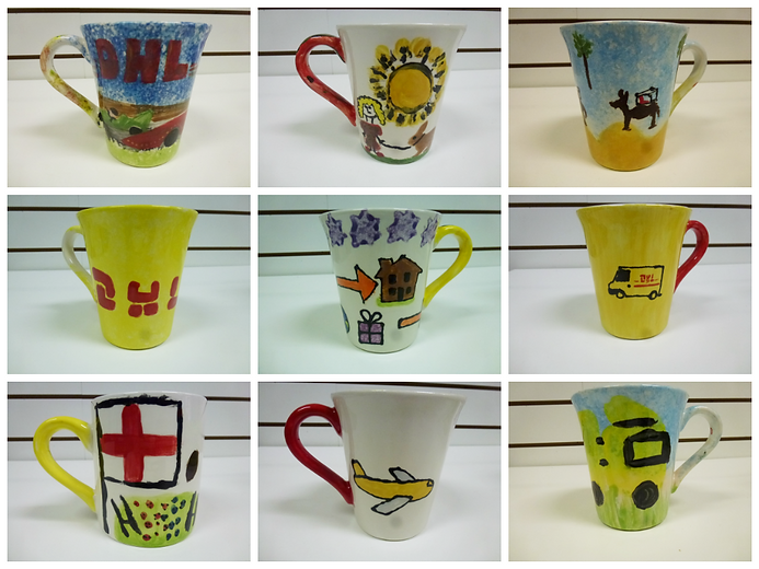 DHL Team Building painted mugs.png