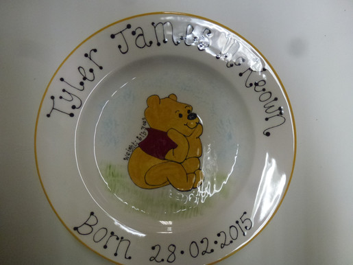 Pooh the bear painted on plate for new born