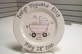 baby in pram painted onto plate