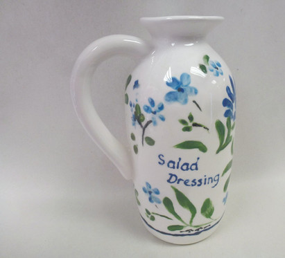 pretty blue flowers painted onto vase
