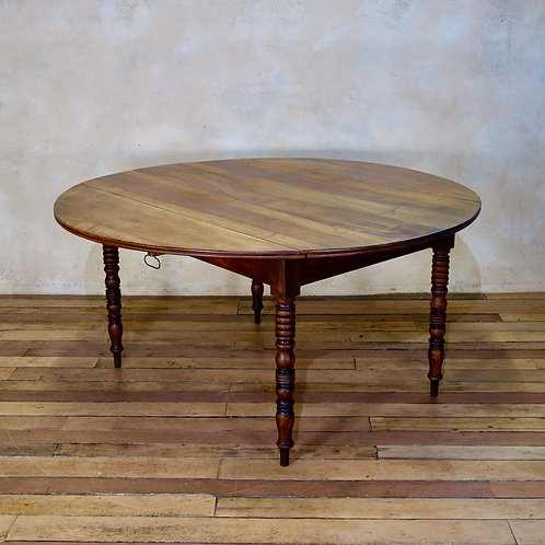 A 19th Century French Chestnut Drop Leaf Table