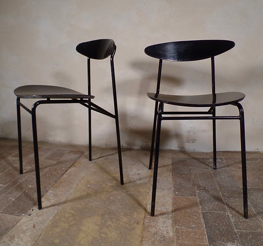 A pair of stackable bentwood chairs