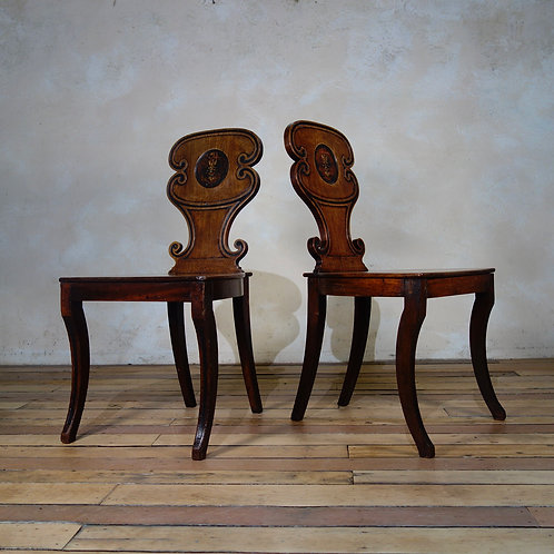 A Pair of Mahogany Regency Hall Chairs