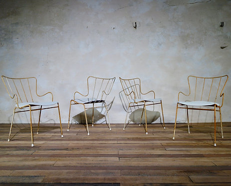 A set of four Ernest Race Antelope chairs