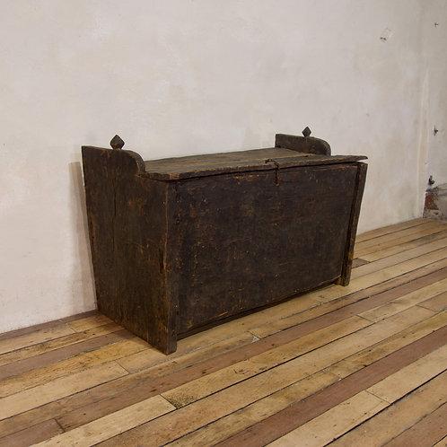 A late 18th Century Primitive Cedar Black Painted Settle - Trunk.