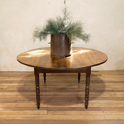 A 19th Century French Chestnut Drop Leaf Table