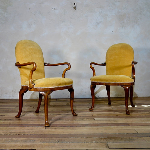 A Pair Of Yellow Upholstered George I Style Shepherd Crook Armchairs