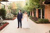 Wedding couple getting wedding photography taken at Fort Worth Stockyards.