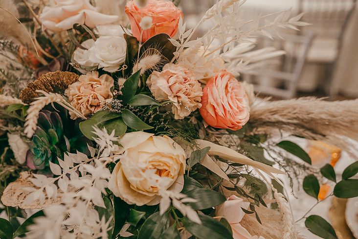 Whimsical bohemian flower arrangement for wedding centerpieces.