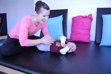 Doctor working with baby on table