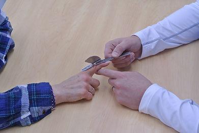 OT measuring patient's finger range of motion