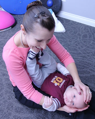 Doctor helping child turn head