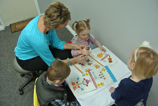 Speech Therapist workig with children in clinic
