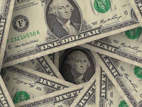 Dólar tem leve alta contra real em meio a tensões entre EUA e China