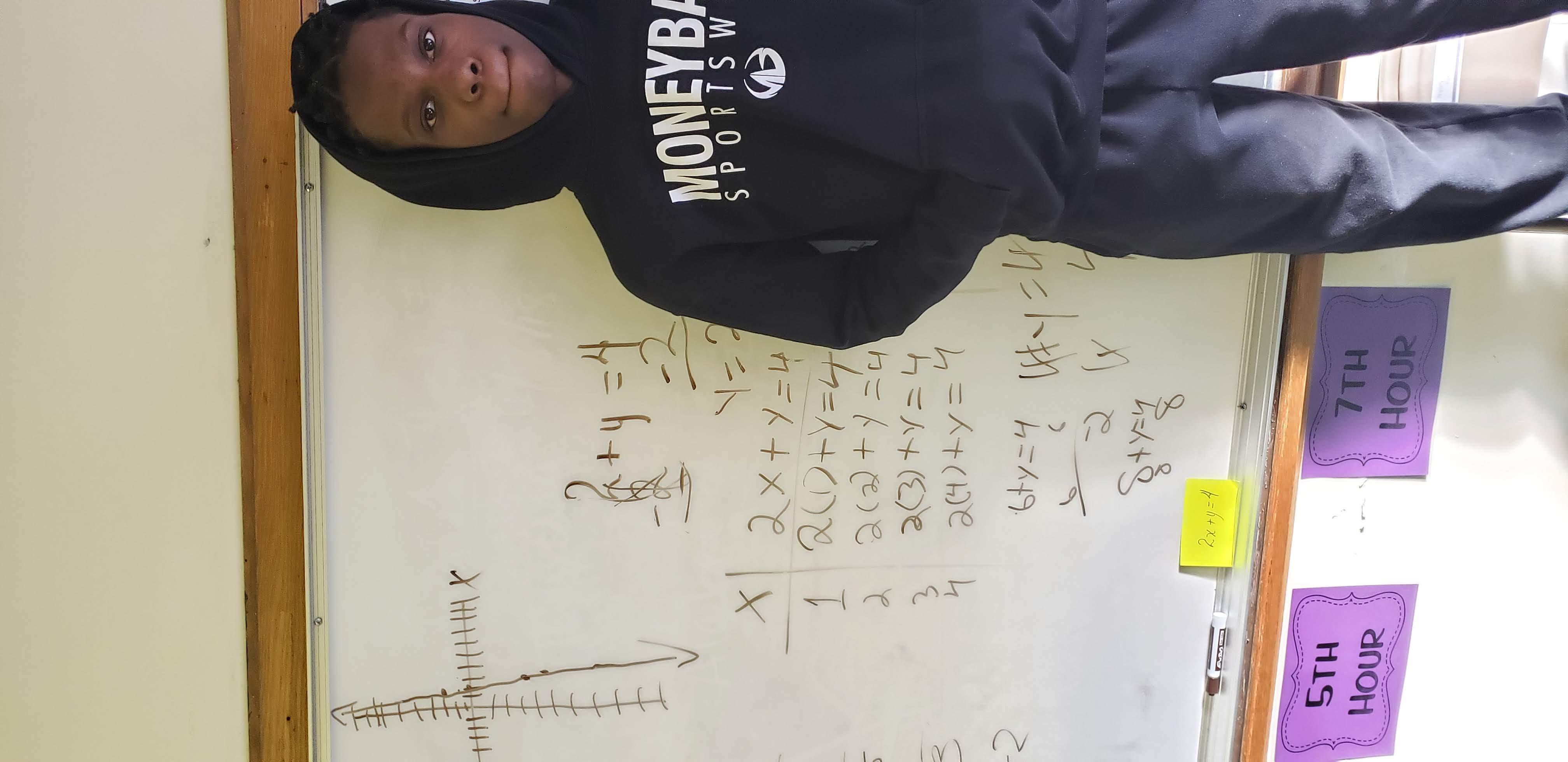 Student proud of his Algebra 1 work