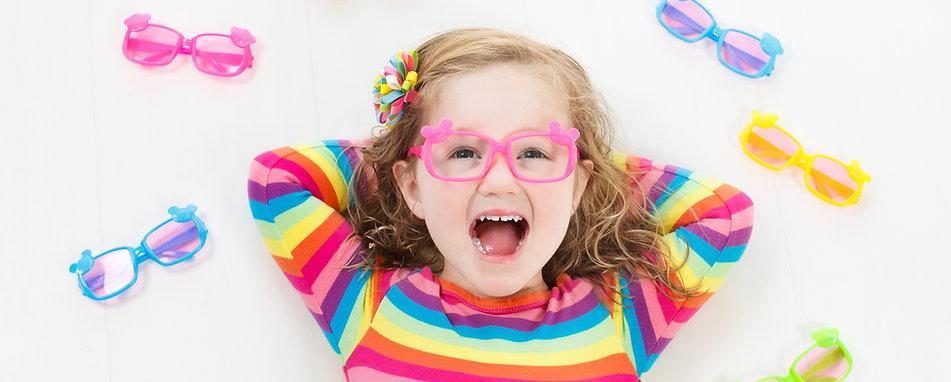 Child At Eye Sight Test. Kid At Optitian