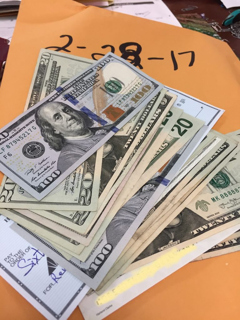 CASH MONEY: Investigators from the State Auditor's office found unsecured cash and checks meant for license renewals at the state Cosmetology Board's offices earlier this year. Photo by the State Auditor's Office