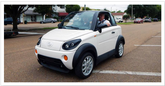 NOT ROLLING: One of the MyCar electric vehicles built at the now-shuttered GreenTech Automotive plant near Tunica takes a test drive in Tunica. Photo by GreenTech Automotive