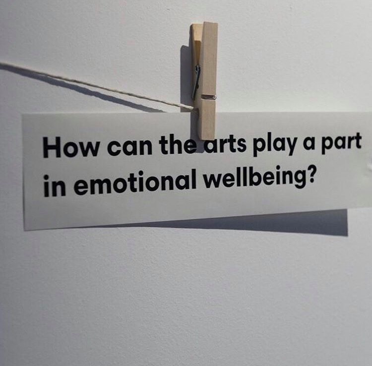 Paper pegged on a string. Reads: How can the arts play a part in emotional wellbeing.