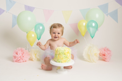 pastel pompoms baby girls birthday cake smash photo photos photoshoot photographer newport, cwmbran, monmouthshire south wales
