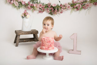 baby girl first birthday cake smash pink flowers photos photographer newport cwmbran monmouthshire south wales