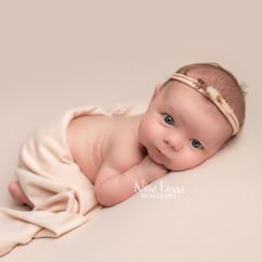 baby girl awake on peach