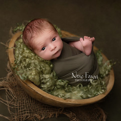 Baby on moss green