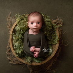 Awake baby in green