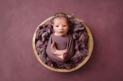beautiful baby girl in purple