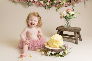 baby girl pink and cream birthday cake smash rustic flowers photos photographer newport cwmbran monmouthshire south wales
