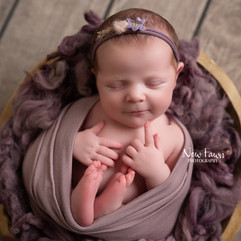 Baby in thoughtful pose