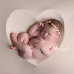 baby in heart bowl