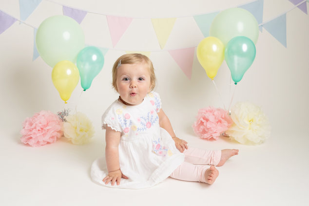 baby girl pastel birthday cake smash photos photographer newport cwmbran monmouthshire south wales