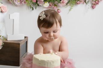 cake eat baby girls birthday cake smash photo photos photoshoot photographer newport, cwmbran, monmouthshire south wales