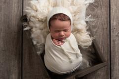 Baby in wooden prop